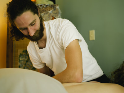 Maxfield Baker offers a deep tissue massage at Blooming Day Spa located downtown San Marcos, TX. To relieve pain and tension, and restore healthy movement, Maxfield uses a range of gentle to heavy pressure techniques.